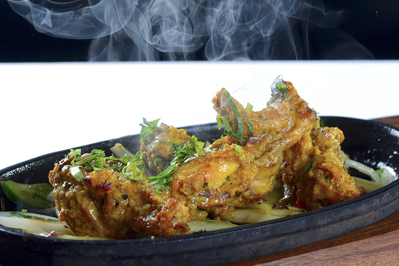 chicken wings on hot plate
