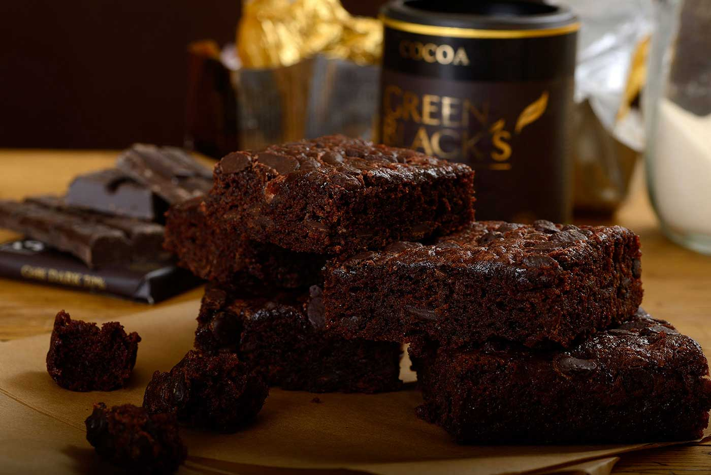 chocolate brownies with ingredients in background