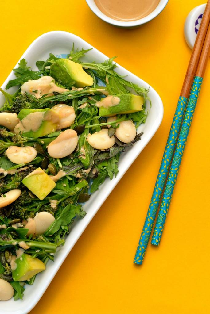 Miso Butter Bean Avocado Salad on a yellow background