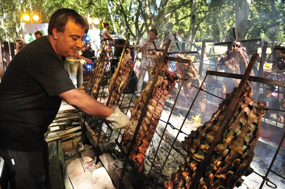 man cooking meat on a BBQ