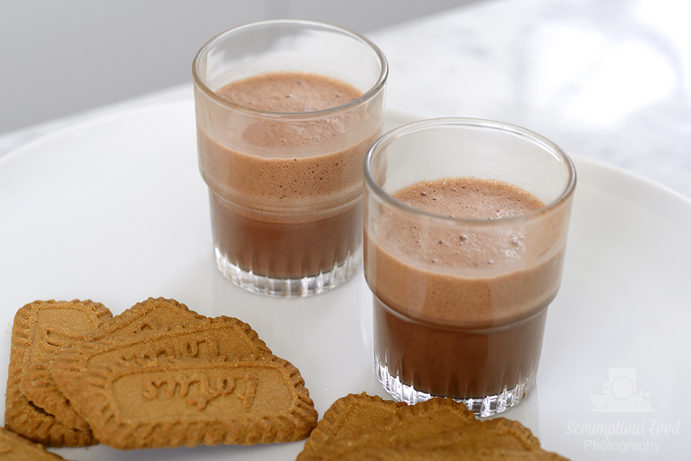 barbajada hot chocolate coffee drink served in glasses on a white plate dressed with biscuits