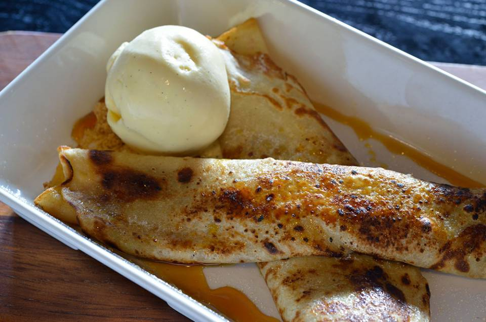 crepe pancakes with vanilla ice cream and caramel sauce
