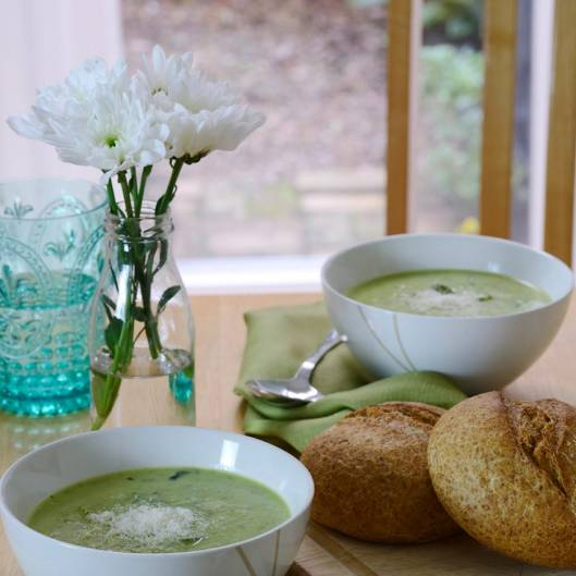 Courgette soup on a table set for two people