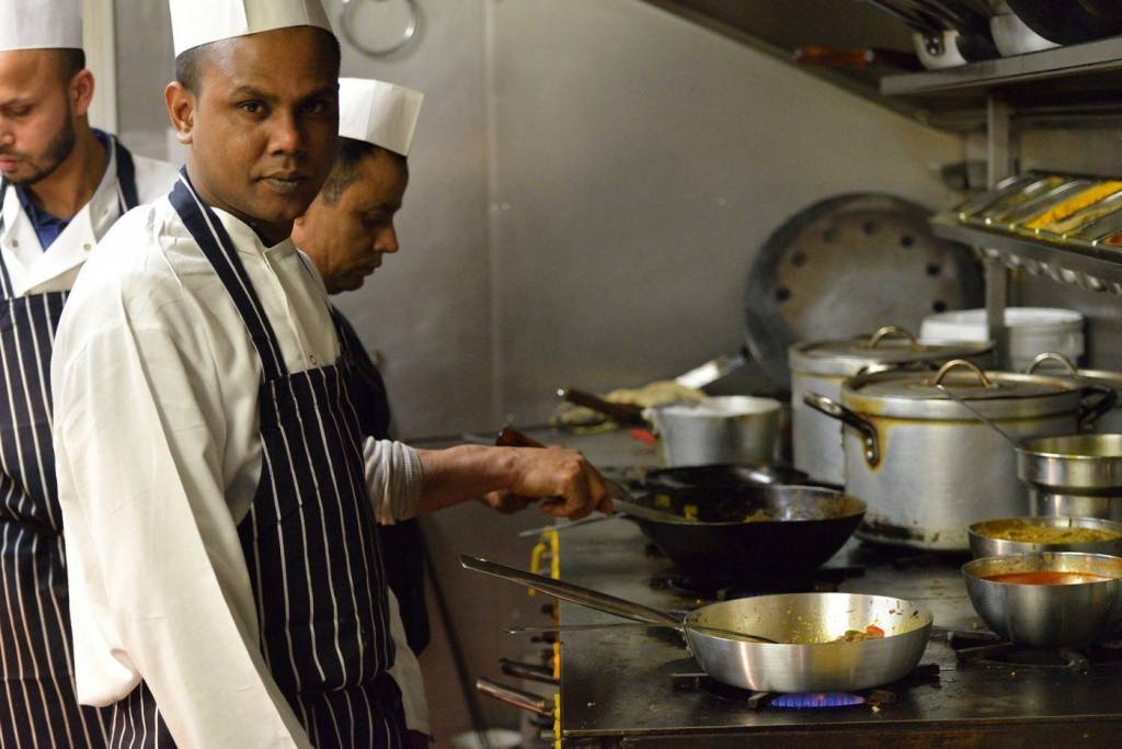 Indian chefs working in the kitchen of a restaurant