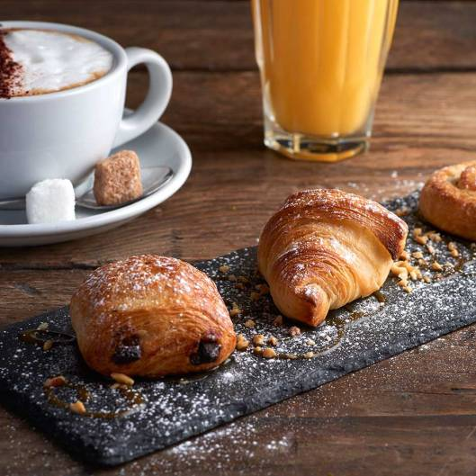 pastries, coffee, orange juice breakfast