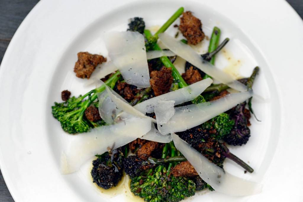 Sprouting Purple Brocoli with cheese on a white plate