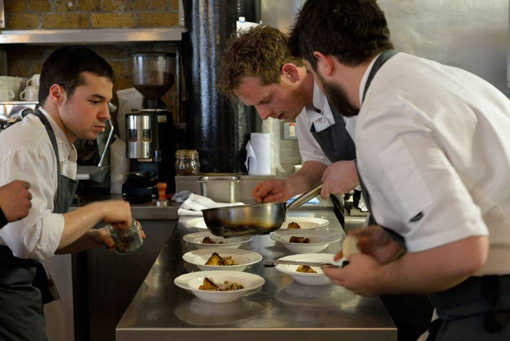 chefs serving up food at the pass