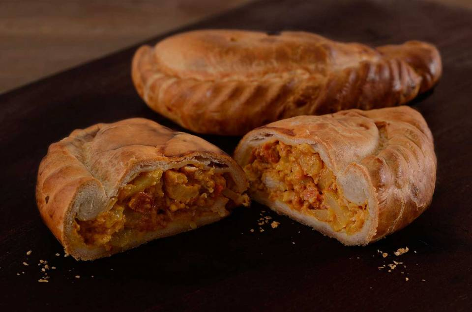 chicken and chorizo pasty cut open and whole pasty in background