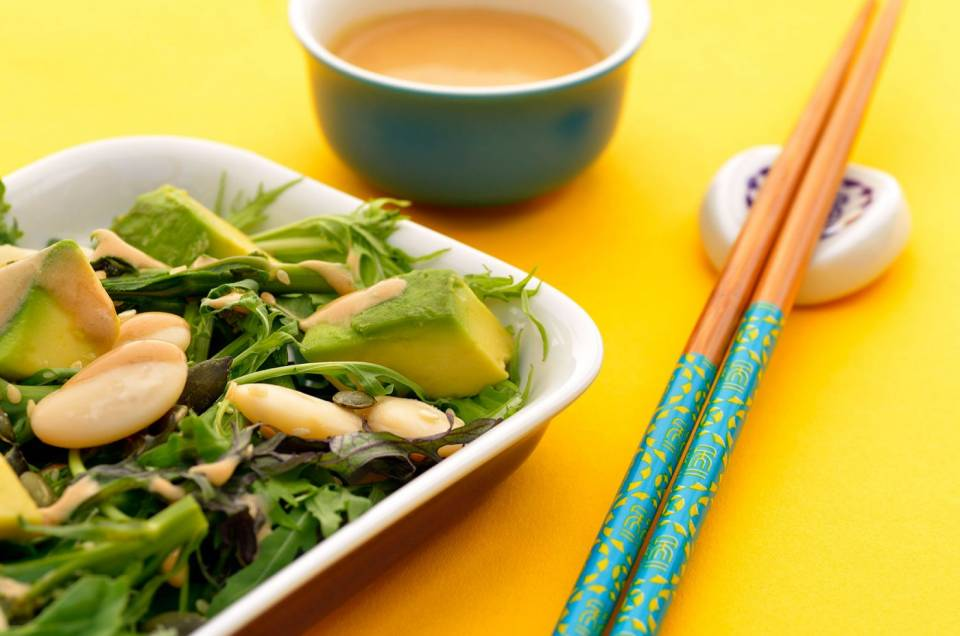 miso butter bean avocado salad on yellow background